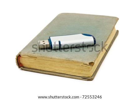 Retro book and flash memory isolated on white background