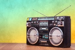 Retro boombox ghetto blaster outdated portable radio receiver with cassette recorder from 80s front gradient colored wall background. Rap, Hip Hop, R&B music concept. Vintage old style filtered photo