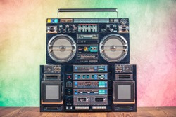 Retro boombox ghetto blaster outdated portable radio receivers with cassette recorder from 80s front gradient colored wall background. Rap, Hip Hop, R&B music concept. Vintage old style filtered photo