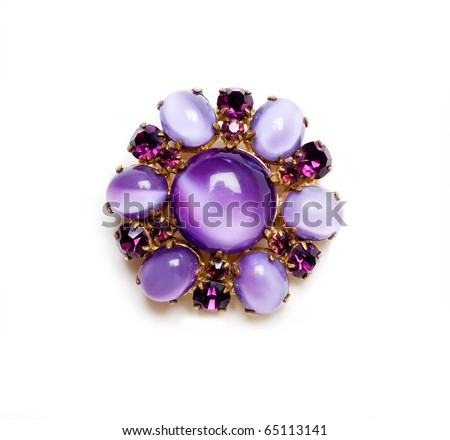 retro brooch with lilac gems isolated on a white