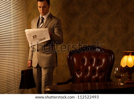 Retro businessman reading newspaper