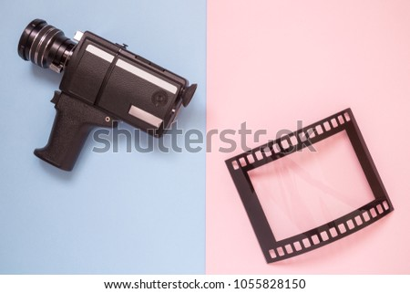 Retro camcorder and photo frame isolated on colorful pastel background minimal creative concept.