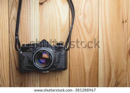 Retro camera on wood table background