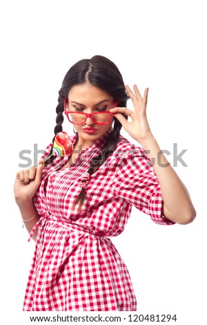 Retro Candy Girl - female student wearing geeky glasses and pigtails, flirting while holding a heart shaped lollipop in her hand