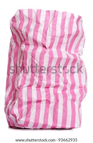 Retro candy stripe sweet bag on white background