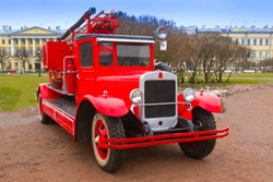 Retro car. Fire team of the last century. The car of firefighters. Red retro car.