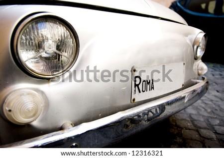Retro car in the street of rome