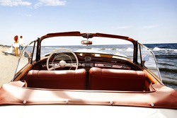 retro car on beach and two lovers