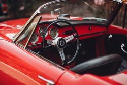 Retro car rally. French riviera. Nice - Cannes - Saint-Tropez. Red retro car concept.
