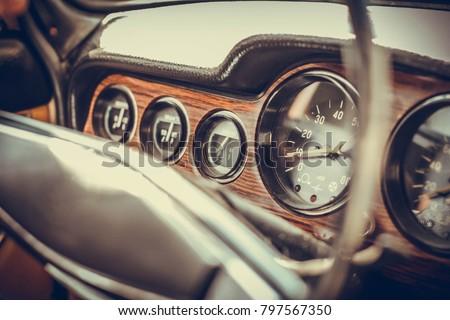 Retro car, retro torpedo car, vintage steering wheel,wooden, speedometer. Interior of a classic russian car.