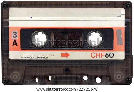 Retro cassette tape from the 80s. All beaten up, faded label colours and dusty. - stock photo