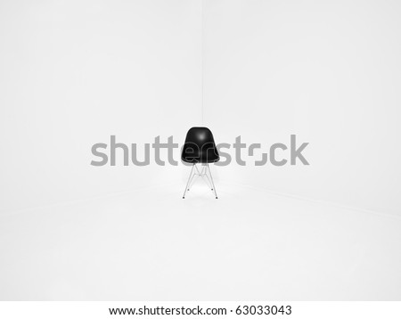 Retro chair in a corner of a white room