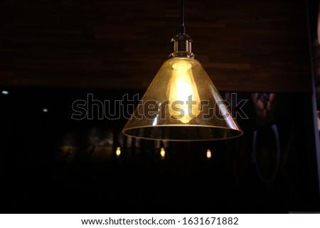 Retro chandelier lamp with bulb hanging in dark closeup  Stok fotoğraf ©