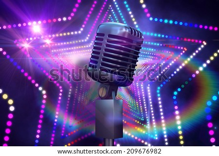 Retro chrome microphone against digitally generated star laser background