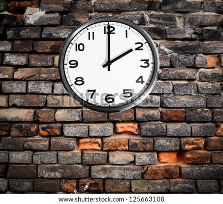 Retro clock on brick wall - stock photo
