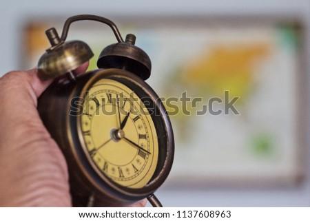 Retro clock with retro map background #1137608963