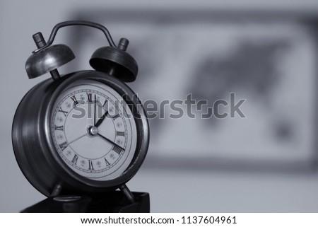Retro clock with retro map background black and white color. #1137604961