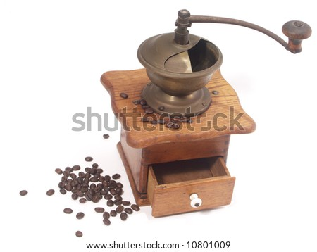 retro coffee-grinder and coffee bean on white  background