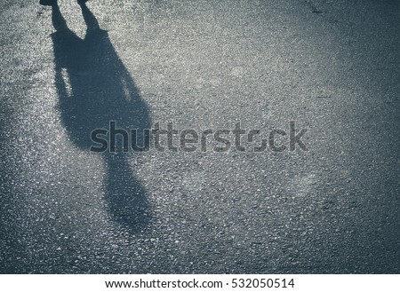 Retro color/ Shadow of a  men on street concrete background with place your text/ Abstract image #532050514