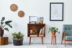 Retro composition of living room interior with mock up poster map, wooden shelf, book, armchair, plant, cacti, vinyl recorder, decoration and personal accessories in stylish home decor.