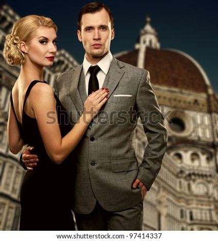 Retro couple against Duomo cathedral, Florence.