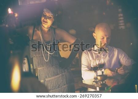 Retro couple.Couple with glasses of red wine in restaurant.Fashion,retro, vintage, tones.Retro couple.Couple with glasses of red wine in restaurant.Fashion,retro, vintage, tones. Antique picture .