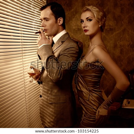 Retro couple near a window