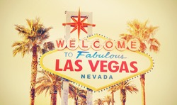Retro cross processed photo of the Welcome To Las Vegas Sign, USA.