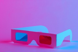 Retro 3d glasses from 80s in trendy neon light. Gradient pink-blue glow. Concept art. Pop culture 80s. Minimalism