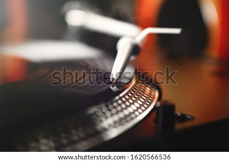 Retro dj turntable player.Turntables needle on vinyl record disc with music.Old analog audio equipment for hip hop disc jockey.Listen to the music in hiqh quality with vintage sound system on party