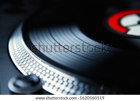 Retro dj turntable.Vinyl record player with analog disc with songs.Listen to favorite classic music in hi fi quality.Professional disc jockey audio equipment.Old style hifi sound system in close up