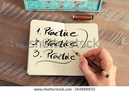 Retro effect and toned image of a woman hand writing a note with a fountain pen on a notebook. Handwritten text PRACTICE, business success concept