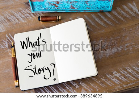 Retro effect and toned image of a woman hand writing a note with a fountain pen on a notebook. Handwritten text What's Your Story ? as business concept image