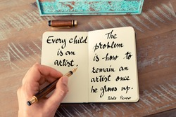 Retro effect and toned image of a woman hand writing on a notebook. Handwritten quote Every child is an artist.  The problem is how to remain an artist once he grows up - Pablo Picasso