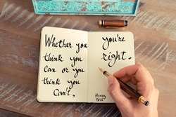 Retro effect and toned image of a woman hand writing on a notebook. Handwritten quote Whether you think you can or you think you can't, you're right - Henry Ford as inspirational concept image