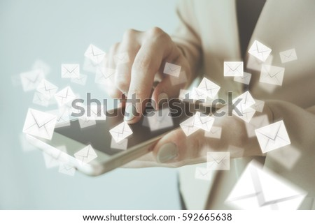 Retro effect of business woman touching smartphone with Mail icon