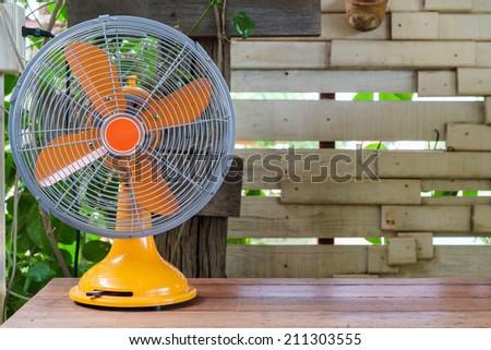 Retro electric fan on wood shelf #211303555