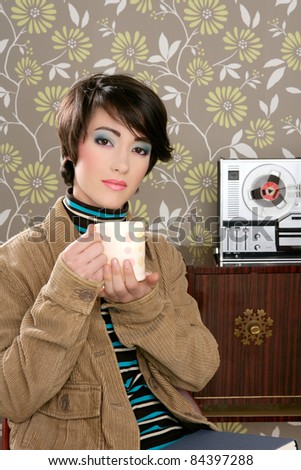 retro fashion 60s woman drinking coffee cup on vintage wallpaper