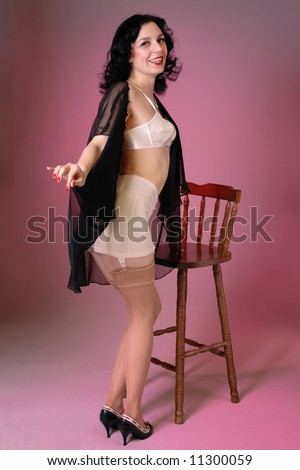 Retro fifties pin-up attractive girl in vintage lingerie on colorful background - pin-up concept