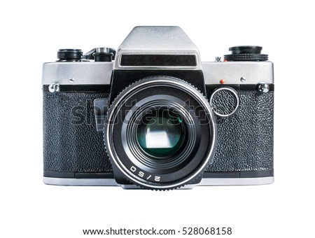 Retro film photo camera isolated on white background