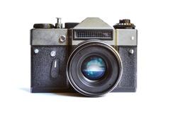 Retro film photo camera isolated over white background