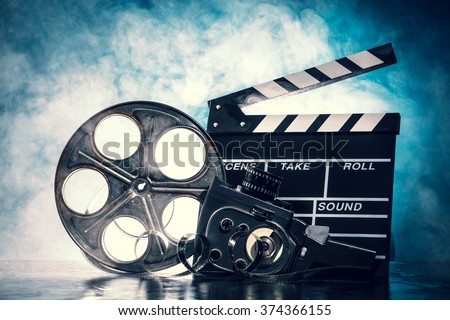 Retro film production accessories still life. Concept of film-making. Smoke effect on background #374366155