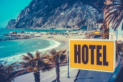 Retro Filtered Photo Of A Vintage Beach Hotel Sign