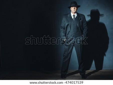 retro 1940 gangster standing in ...