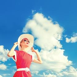 retro girl on the blue sky background