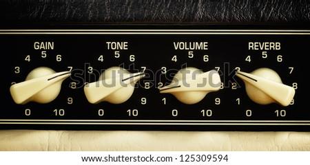 retro guitar amplifier control panel, close up