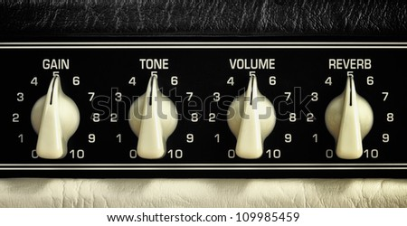 retro guitar amplifier control panel, middle position, close up