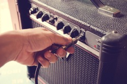 retro guitar amplifier control panel with jack