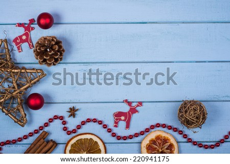 Retro hand made natural Christmas decoration with copy space on wooden background