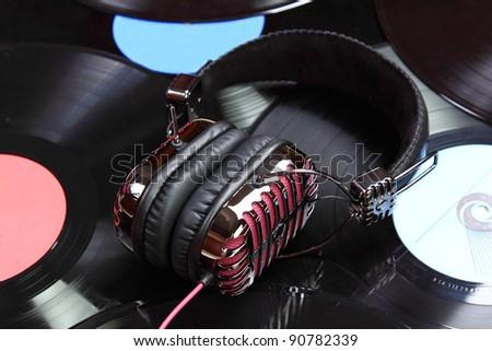 Retro headphones and vinyl records and cd